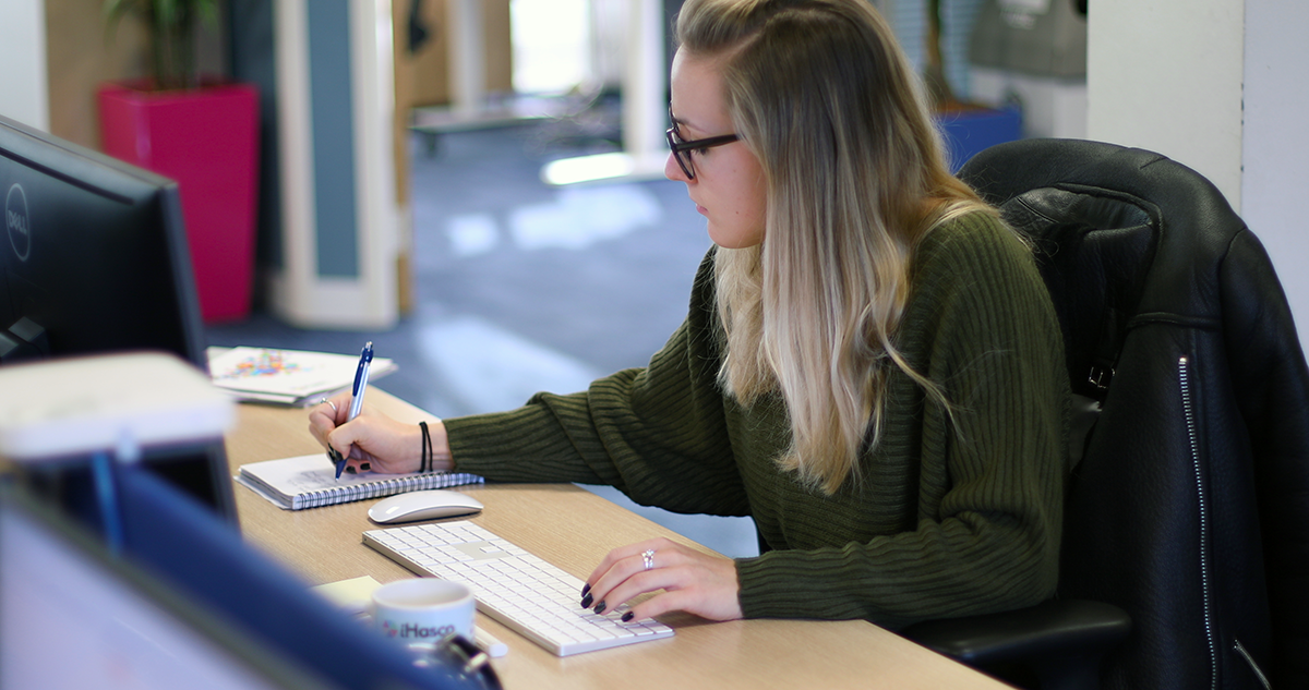 An employee undertaking a training course online