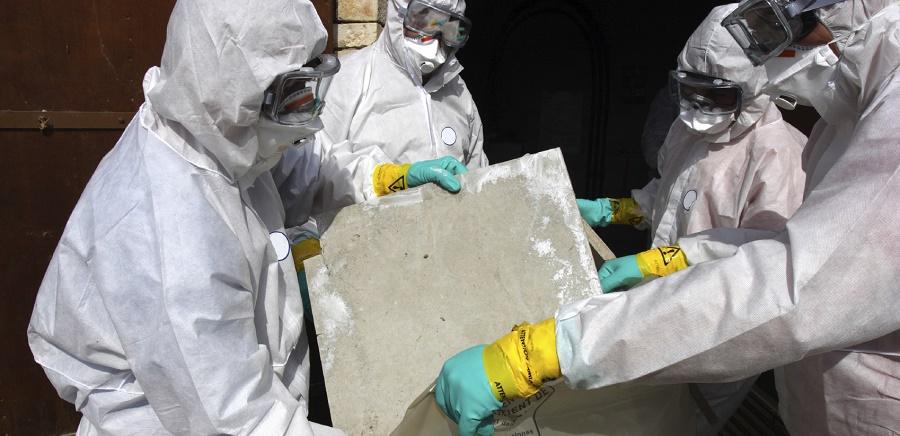 People wearing PPE disposing of Abestos