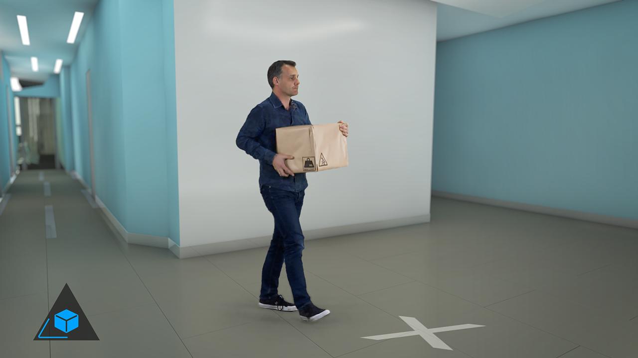 Man carrying a box using good manual handling techniques