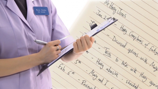Image showing carer keeping records of her patients