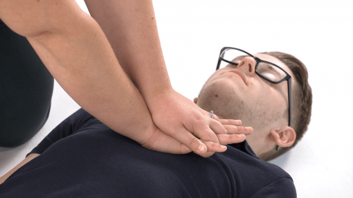 A paramedic performing CPR