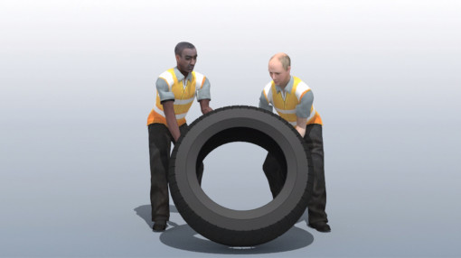 Two men manual handling and lifting a tyre