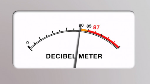 A decibel meter rising to show noise awareness in the workplace