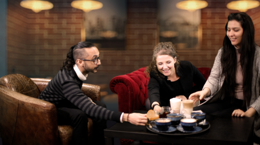 Image of 3 colleagues at a coffee shop